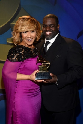 LOS ANGELES, CA - FEBRUARY 08:  Winner of Best Gospel Album Erica Campbell (L) and producer Warryn Campbell pose at the Premiere Ceremony during The 57th Annual GRAMMY Awards at Nokia Theatre L.A. LIVE on February 8, 2015 in Los Angeles, California.  (Photo by Alberto E. Rodriguez/WireImage)